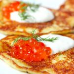 Latkes with Salmon Roe and Sour Cream as seen on The Jewish Kitchen website