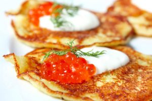 latkes with salmon roe and sour cream from The Jewish Kitchen